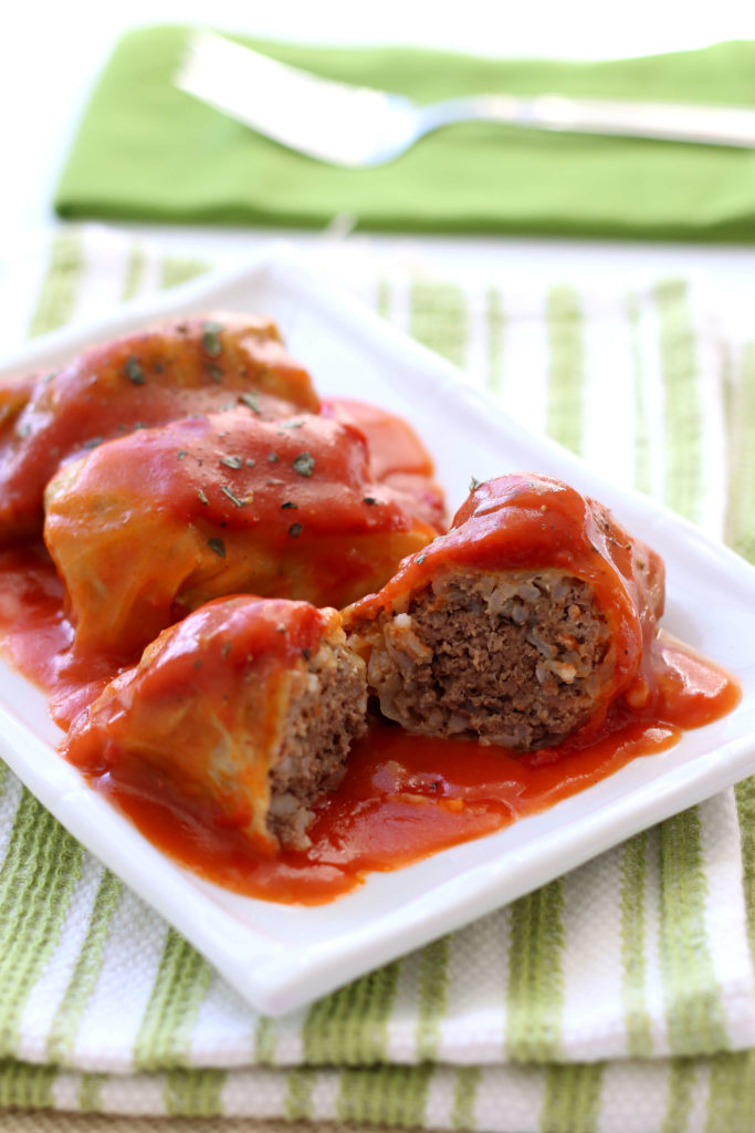 a cut open cabbage roll on a white plate