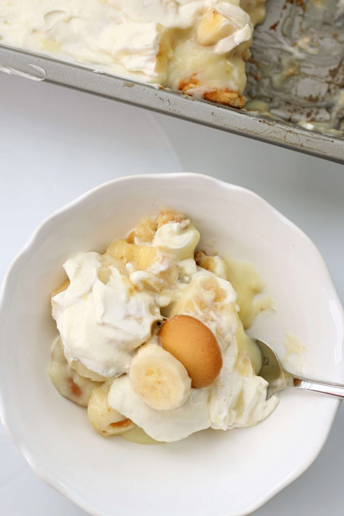 pudding with whipped cream and nilla wafer