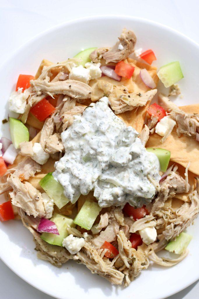 greek nachos on a white plate