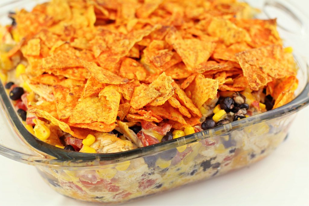 a baking dish with doritos casserole inside